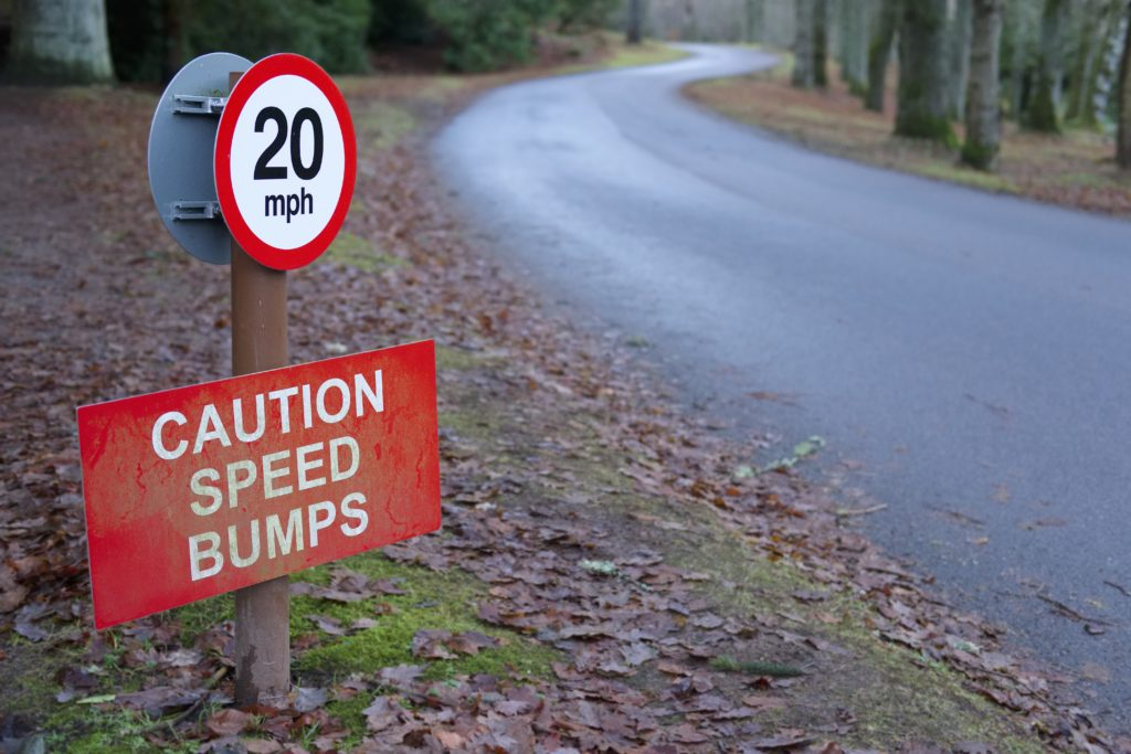 Speed Bumps Caution 20 mph Sign